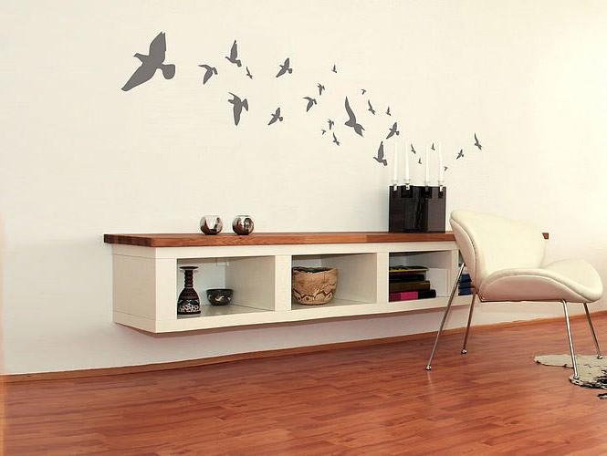 Wall sticker flock of grey birds in living room interior for Stickers decorativos