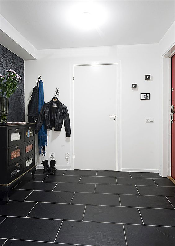 Contemporary black white apartment with wood interior for Contemporary theme in interior design