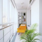 Coridor Reading Nook with Orange Chairs and Plants