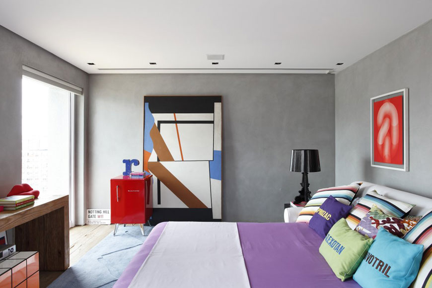 Grey Color Main Bedroom in Apartment with Red Accents
