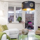 Minimaist Apartment Living Room with White Sofa and Green Rugs