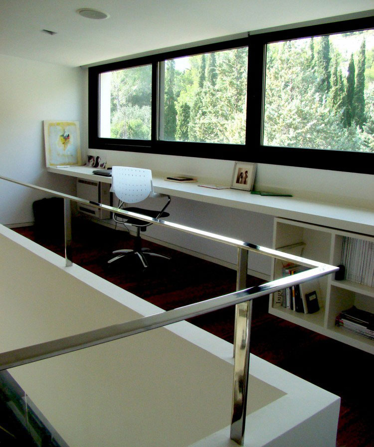 Modern Home Workspace with Forest View
