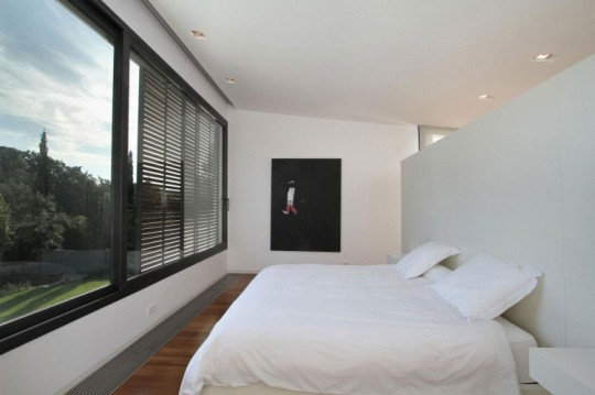 White Second Bedroom with Large Glass Window