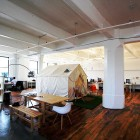 A Fun Working Space With a Tent and Wood Table Garden Set