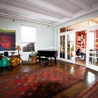 Artsy Working Space with Turkish Rugs and Black Piano