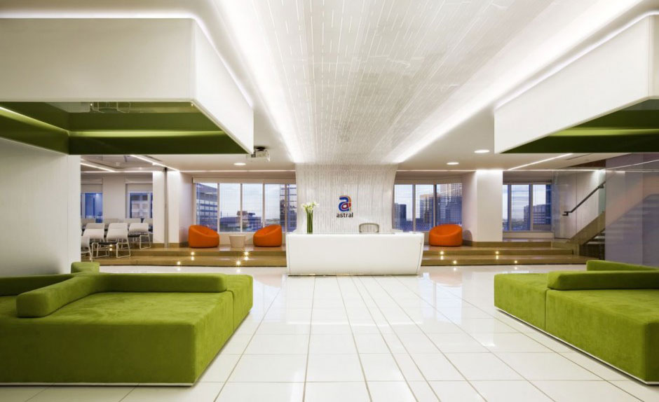 Bright Colored Office Receptionist and Waiting Room with Green Sofas