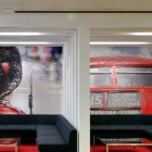 Meeting Room with Black Sofa and Red Bus Wall Decor
