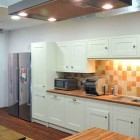Moder Kitchen Design with Orange Tile Wall