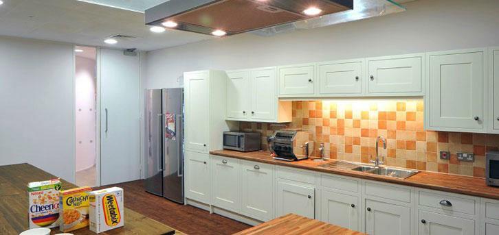 Moder Kitchen Design with Orange Tile Wall