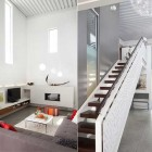 Modern Wood and White Stairs Design Beside Living Room