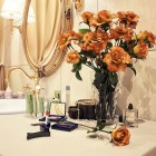 Orange Flowers in a Warm Sink Bathroom