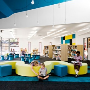 Colorful Elementary Library with Unique Wave Couch
