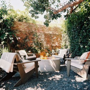 Fire Pit in Garden with Four Sofa Surrounding