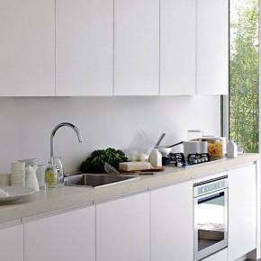 Modern White Kitchen With Great Natural Lighting and Slidding Glass Door