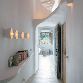 Unique Cave Home Hallway with Old Door Design