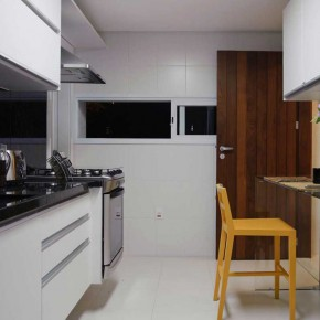 White Kitchen Design with Yellow Chairs
