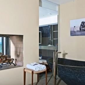 Minimalist Castle Bathroom with Black Stone Bathtub