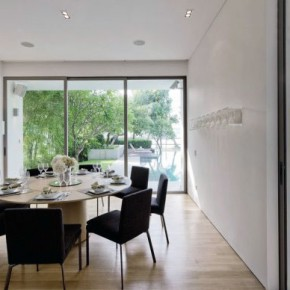 Neutral Dining Room with Retractable Glass Walls