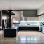 Black Kitchen Countertop with Polished Concrete Floors