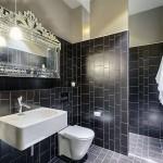 Black Tile Wetroom Design with White Washbasin