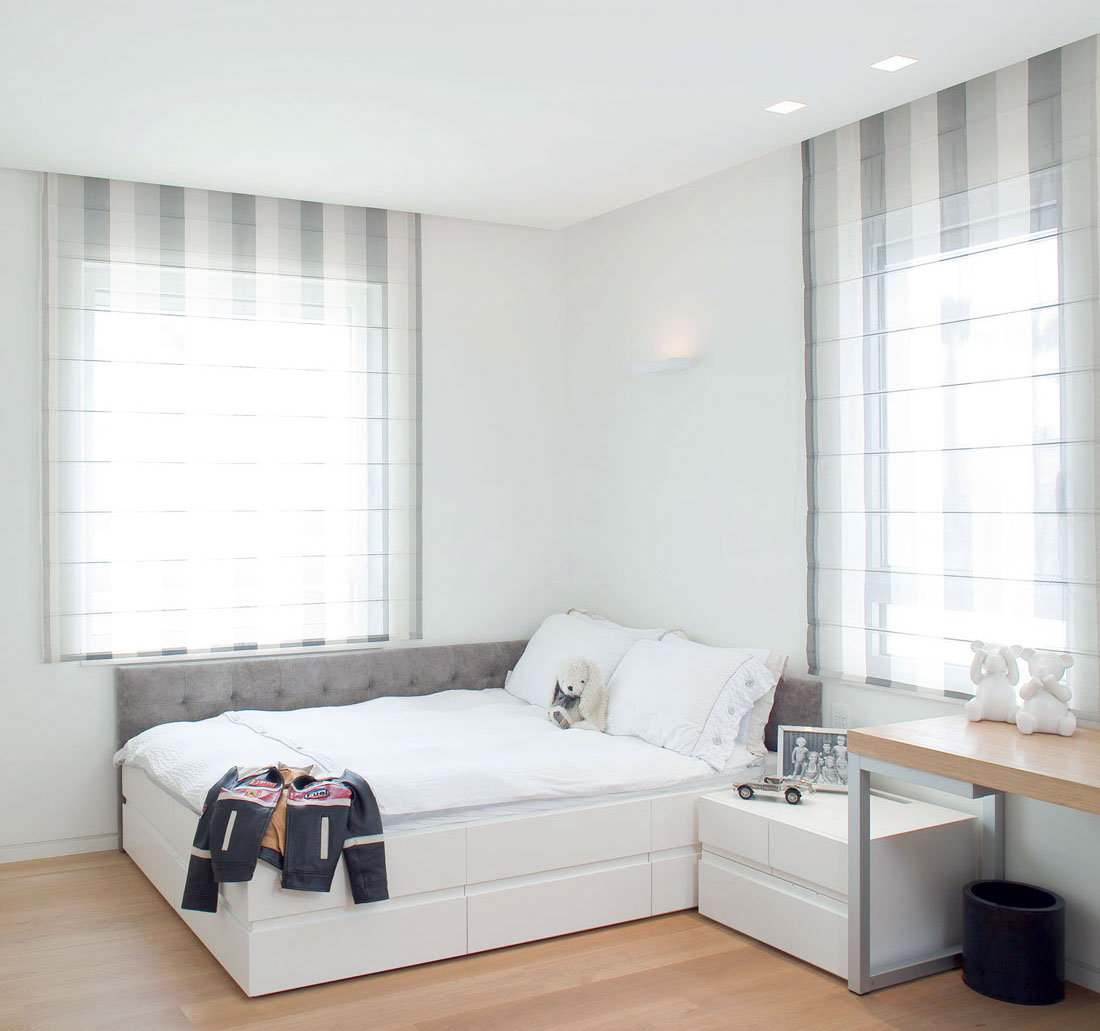 Bright white girls bedroom with wooden floor
