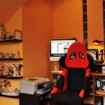 Comic Figurine Colletor Workspace with Orange Colors