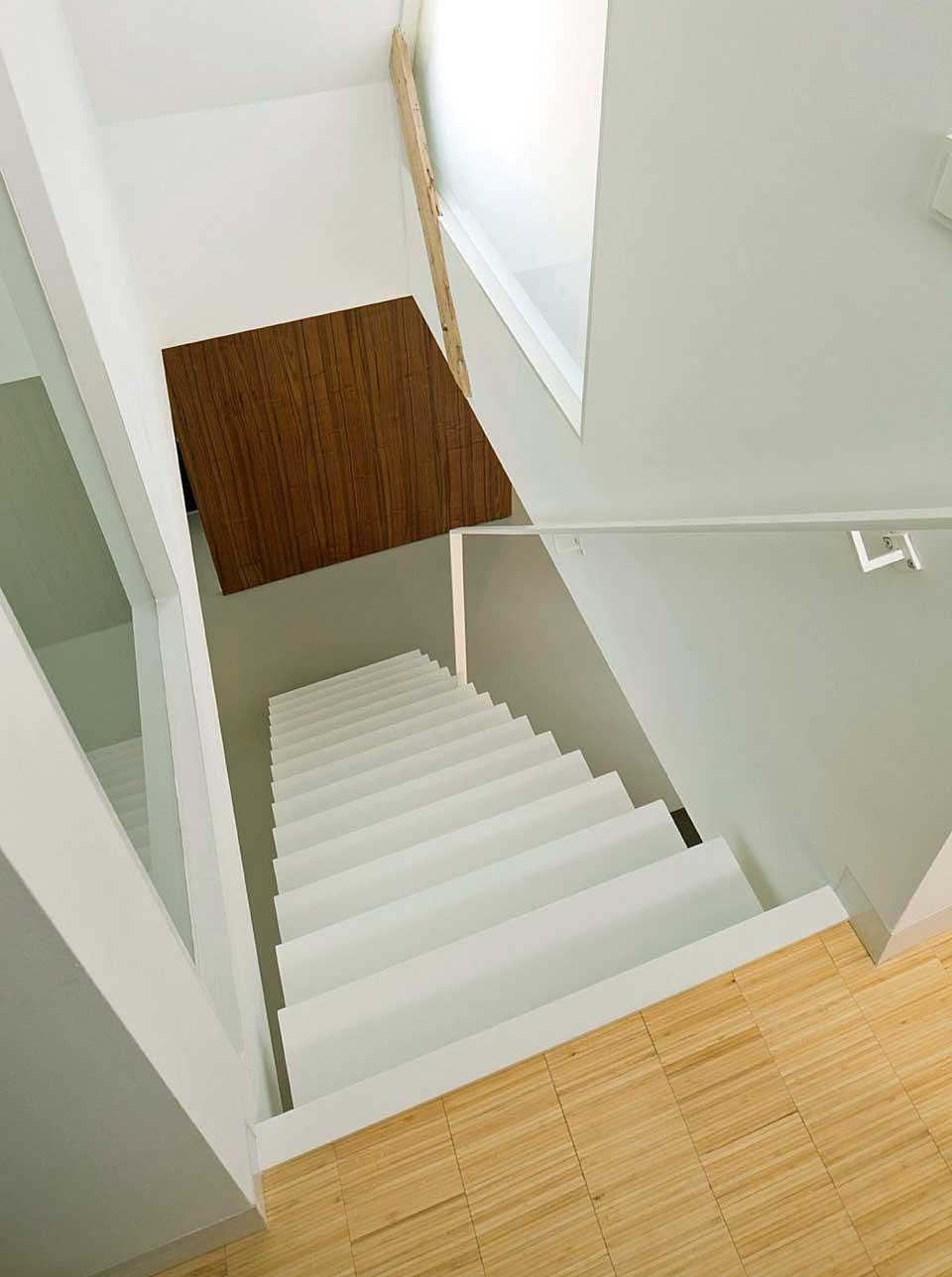 Minimalist White Stairs Apartment