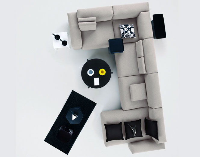 Modern Grey Modular Sofa with Black Pillow and Table