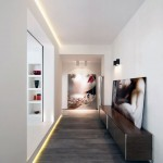 Modern Hallway with Recessed Wall Lighting and Wooden Floor