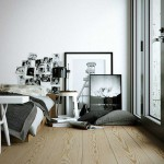 Monochrome Bedroom with Wooden Floor and Glass Door