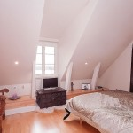 Bright Attic Bedroom Design with Wooden Floor