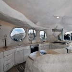 Creative Flintstone Style House Cave Rock Kitchen Round Windows Design