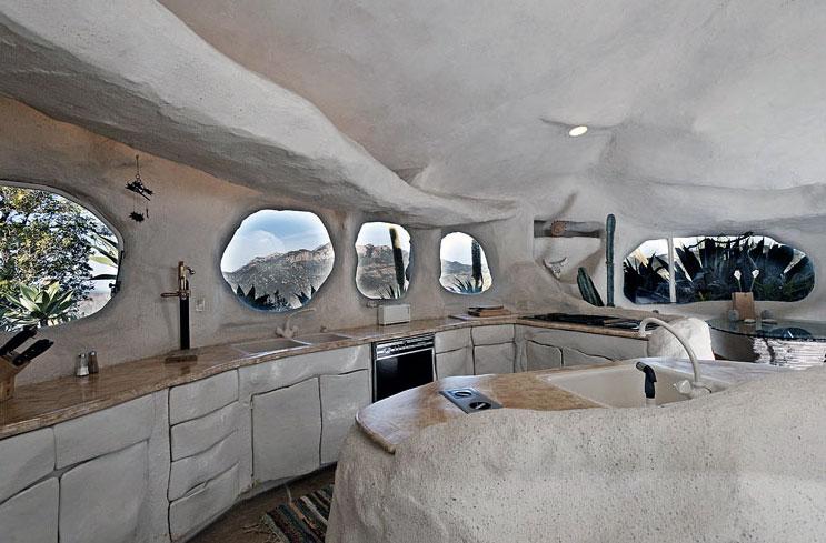 Creative Flintstone Style House Cave Rock Kitchen Round Windows Design