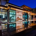 Living Room Across Pool with Large Expanses of Glass