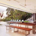 Modern Dining Room Open Living with Bi-fold Glass Doors