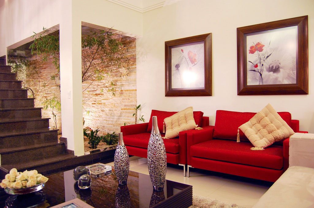 Modern White Living Room With Red Sofa And Courtyard