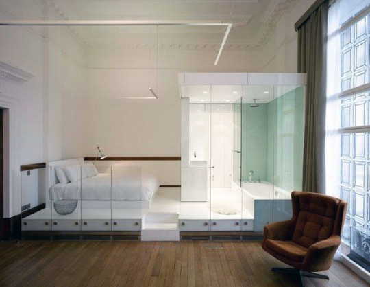 Unique White Bedroom Bed and Bathtub in One Area