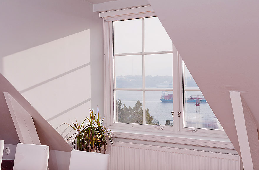 White Sloped Ceiling Window with Lake Malaren Views