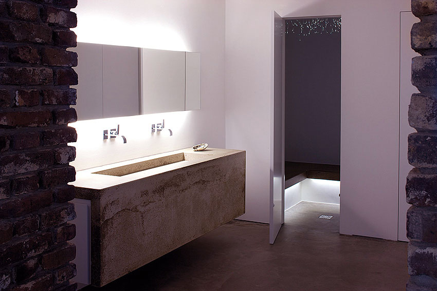 Modern Concrete Basin Design with Large Mirror