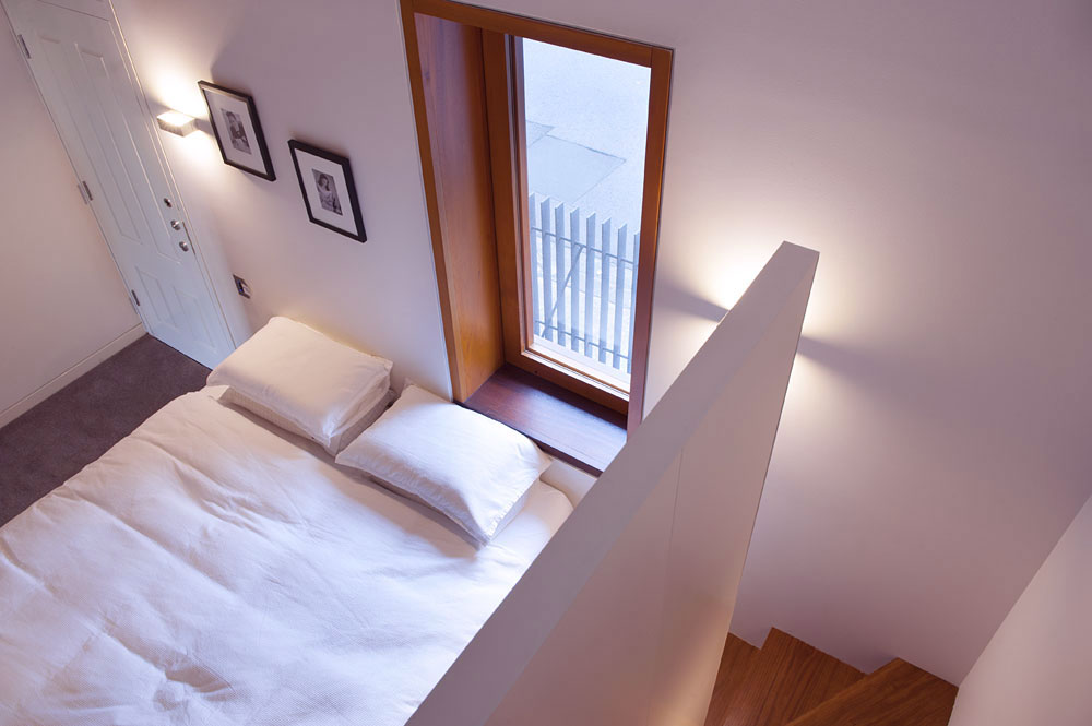 Modern Small Bedroom with Stairs to Attic