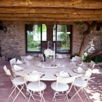 Outdoor Dining Room with White Table and Table Manner