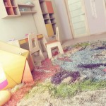 Cool Kids Bedroom with Colorful Rug and Yellow Chair