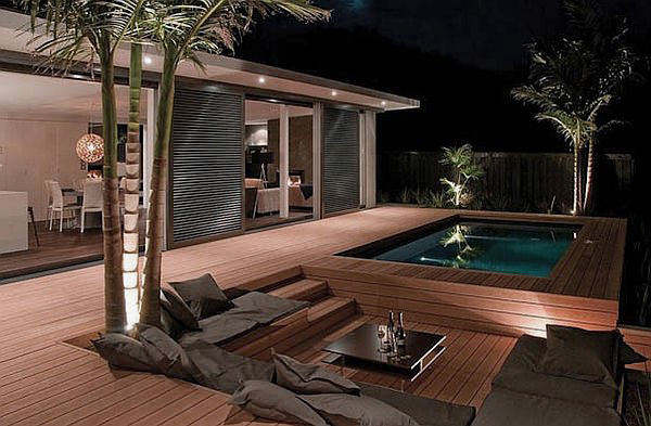 Fascinating outdor patio design with wooden deck and pool for Wood pool deck design