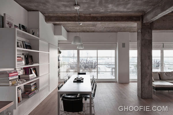 Concrete Dining Room Design with White Storage