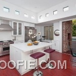 Elegant Kitchen Design with Wooden Floors and White Island