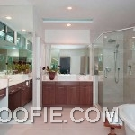 Luxurious Bathroom Design with Wooden Storage and Glass Shower Box