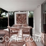Elegant Patio Design with Rattan Chair and Outdoor Dining Table
