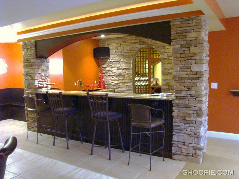 Natural stone wall padded barstools contemporary home bar for Hidden home bar ideas