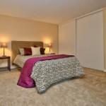 Warm bedroom with sliding door closet