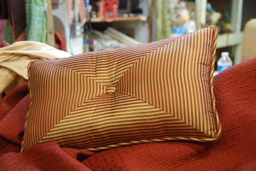 Maroon and gold throw pillows